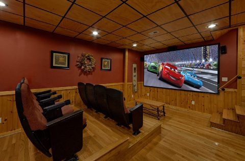 Theater room with 10 foot screen in luxury cabin - A Bear Affair