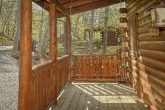 2 bedroom cabin with porch swing and hot tub
