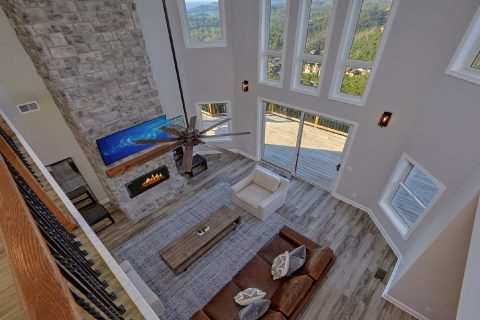 Luxurious cabin living room with stone fireplace - A Castle in the Clouds