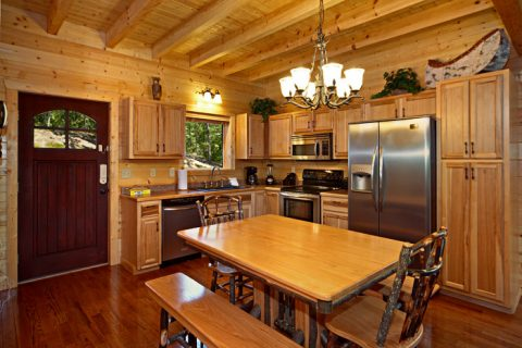 Cabin with Stainless Steel Kitchen Appliances - A Friendly Forest