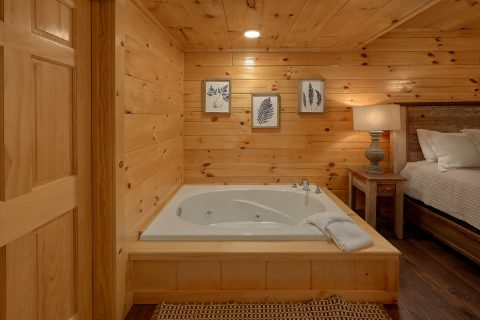 King Bedroom with Private Jacuzzi Tub in cabin - A Mountain Palace