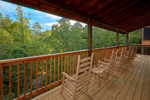 Luxury Cabin with Rocking chairs and wooded view - A Mountain Palace
