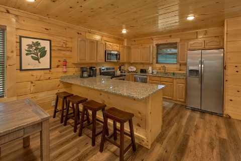 Spacious kitchen and dining area in cabin rental - A Mountain Palace