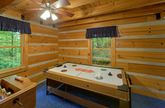 2 bedroom cabin with air hockey game