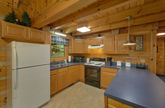 Fully stocked kitchen in cozy 2 bedroom cabin