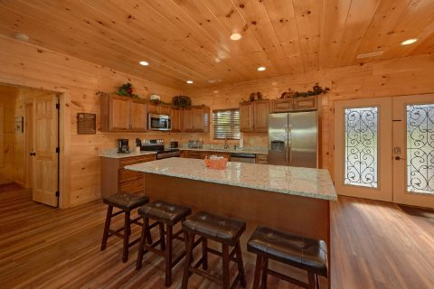 Luxurious kitchen with granite counters in cabin - A River Retreat