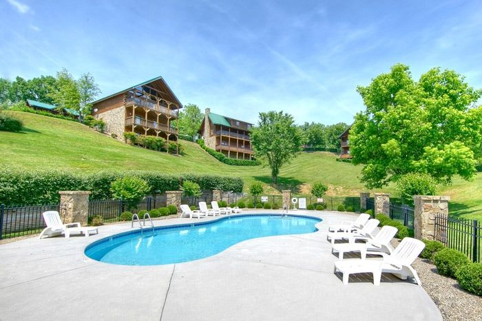Cabin with wooded view and pool access - A Smoky Mountain Experience