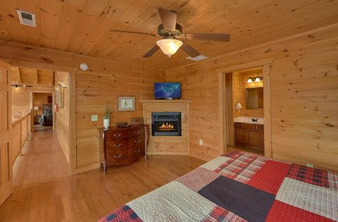 Cabin Master Bedroom with fireplace and TV - A Spectacular View to Remember