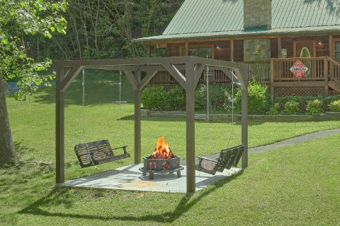 Fire Pit with swings at premium 2 bedroom cabin - Absolute Heaven