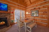 Cozy cabin with dining room and kitchen