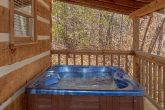 Secluded cabin with private hot tub on deck