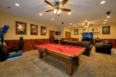 Cabin with Pool Table and Race Car Arcade Games