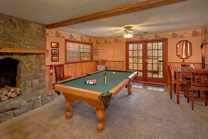 Game Room with Pool Table and Fireplace in Cabin - Amazing Majestic Oaks