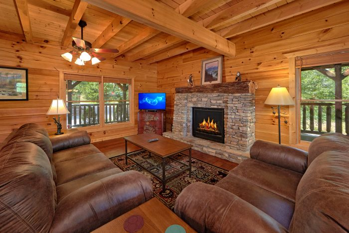 Spacious Living Room with Stone Fireplace - American Dream Lodge