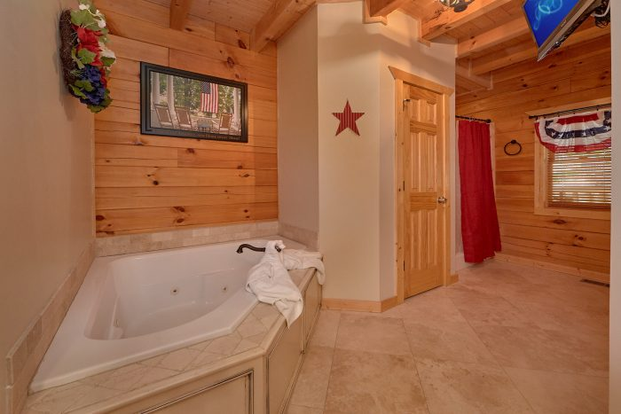 Private Jacuzzi Tub in Master Bedroom in Cabin - American Dream Lodge