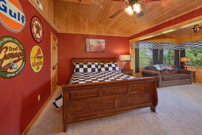 King Bedroom with Sleeper Sofa and TV Area - American Dream Lodge