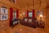 Spacious living room with fireplace in cabin