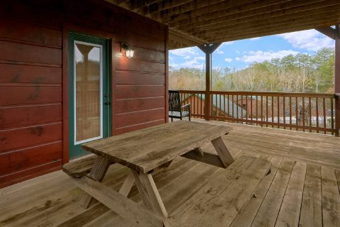 Cabin with picnic table and hot tub on deck - Bear Cove Lodge