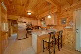 Kitchen in 3 bedrom cabin with bar seating