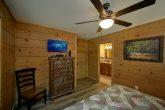 Main Floor King Bedroom with Flatscreen TV