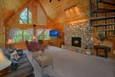 Cabin with Large Stone Fireplace and View