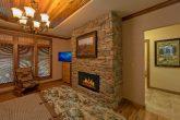 Queen bedroom with fireplace in 6 bedroom cabin