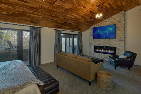 Master bedroom with fireplace in luxury rental - Bluff Mountain Lodge