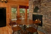 Double Sided Stone Fireplace in Dining Room