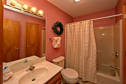 Bathroom with Shower/Tub Combo - Cinnamon Cottage