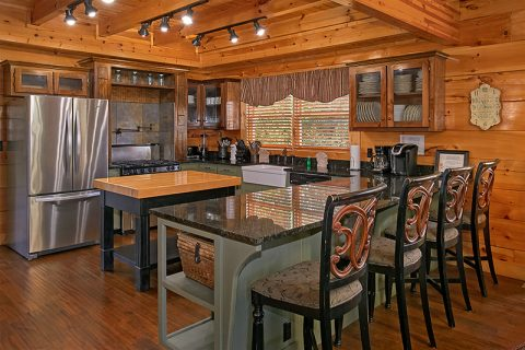 Family Size Kitchen with Bar seating in Cabin - C'Mon Inn