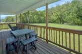 2 bedroom cabin with picnic table on the river