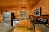5 bedroom cabin with full kitchen and bar seat