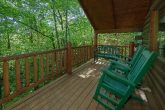 1 bedroom cabin with porch swing and wooded view