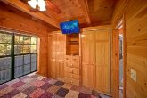 cabin with bedroom TV