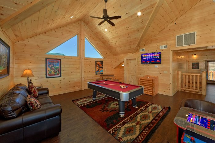 Game room with pool table and sleeper sofa - Endless Sunsets