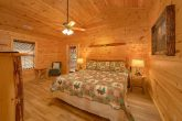 King bedroom on main level in 3 bedroom cabin