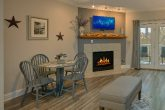 Golf View Condo with dining area and fireplace