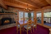 Cabin with a fireplace in Dining Room