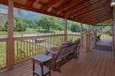 Cabin with Rocking chairs, porch swing and table