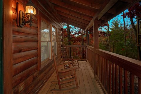 Cabin with Rocking Chairs on Covered Front Porch - It's About Time