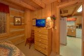 King bedroom with TV in Rustic cabin
