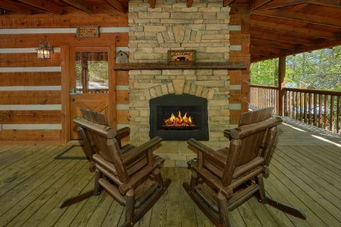 Rustic Cabin with outdoor fireplace and rockers - Kicked Back Creekside
