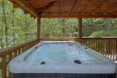 Cabin with private hot tub and fireplace on deck