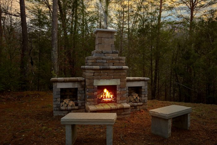 Stone Firepit at 1 Bedroom Honeymoon Cabin - Knotty and Nice