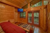 Master bedroom with private deck access in cabin