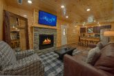 Cozy Living room with fireplace in cabin rental
