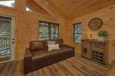 2 bedroom cabin with couch in game room