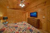 King bedroom with TV in 3 bedroom cabin rental
