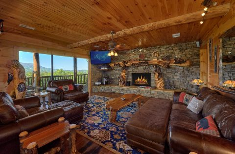 Spacious living room with stone fireplace - Majestic Peace