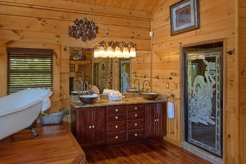 Cabin bathroom with luxurious bath tub - Majestic Peace